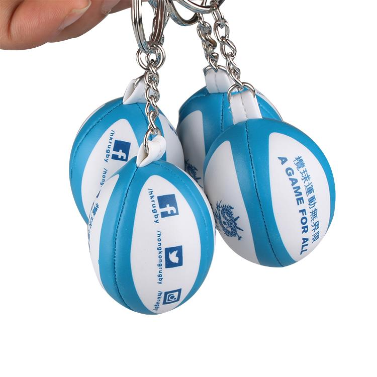 Promotion soft PVC Leather mini rugby ball keychains with custom Logo